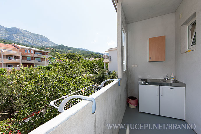 mini kitchen on balcony with view on mountain Biokovo