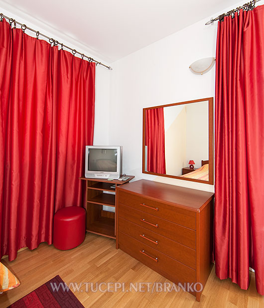 dressing table, TV, window treatment, curtains
