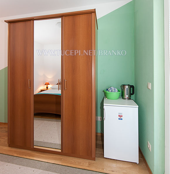 wardrobe, dressing mirror, refrigerator, water kettle