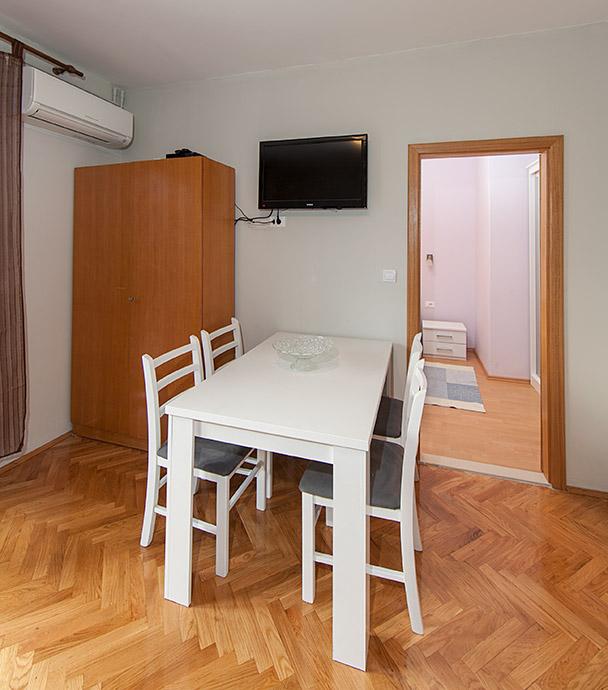 dining table, TV, air-condition, open door of bedroom