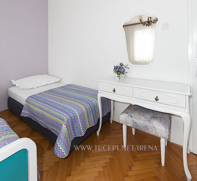 third bed in first bedroom, dressing table and mirror