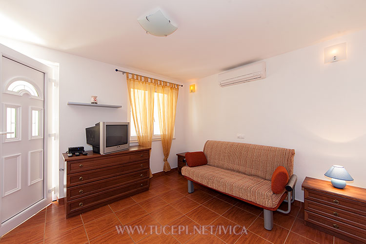 living room with sofa, multimedia set, table lamps, etc