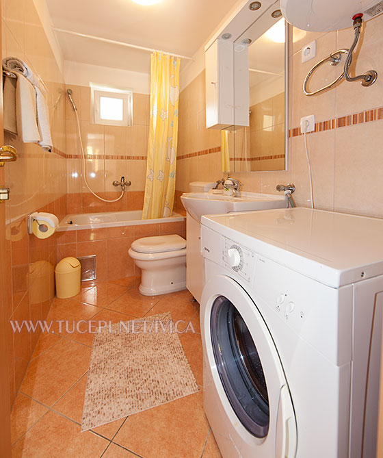 bathroom with laundry washer