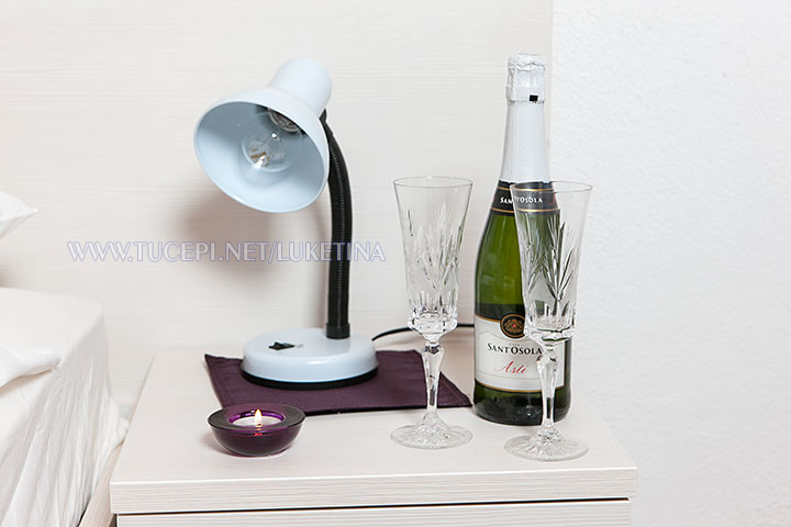 wine and glasses on the night table