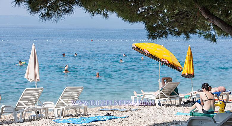 Tučepi beach - sunning on deck chair