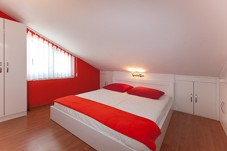 nice colored and equipped bedroom