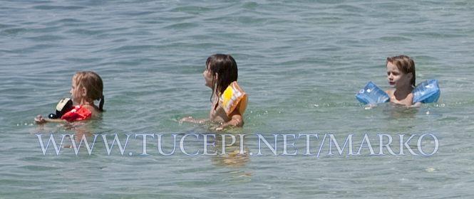 children plays in the sea, Tučepi