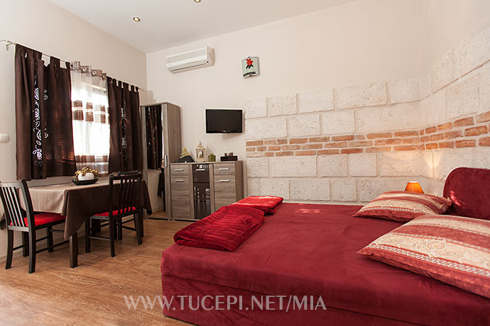 beds, dinning table, TV