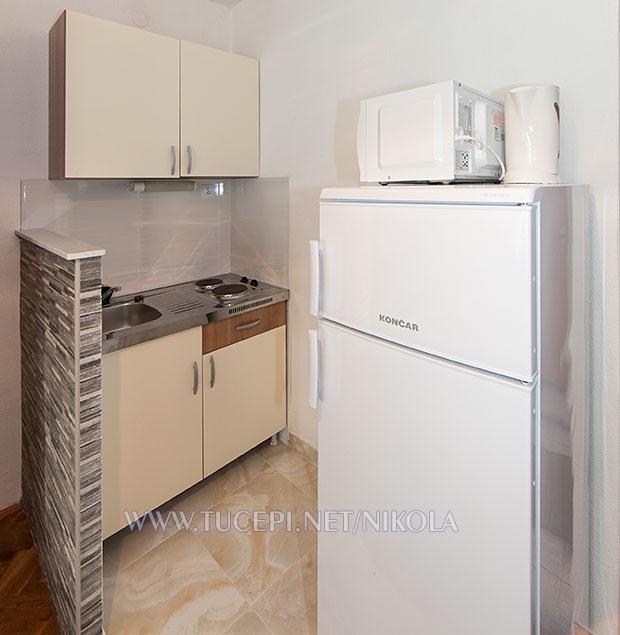 refrigerator, microwave oven, kitchen