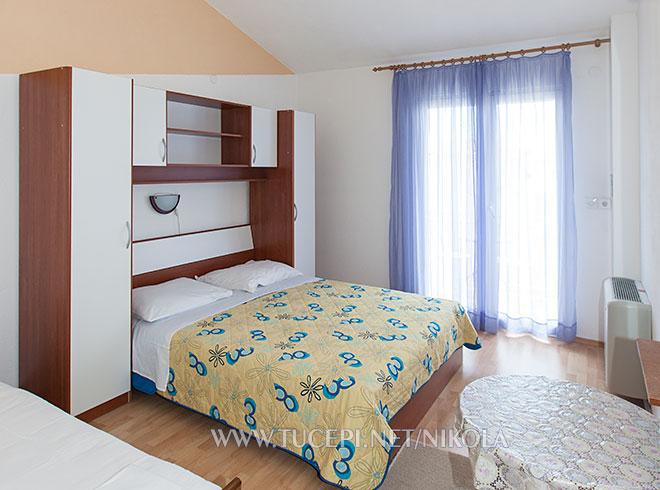 bedroom with bridge wardrobe, air-conditioned