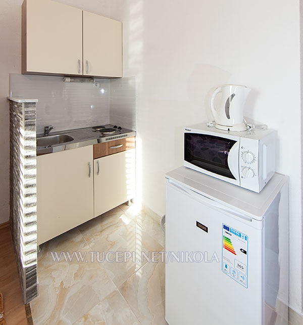 kitchen with microwave oven and coffeee maker