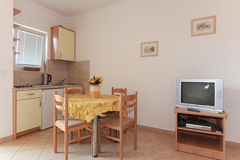 dinning table, kitchen, tv set